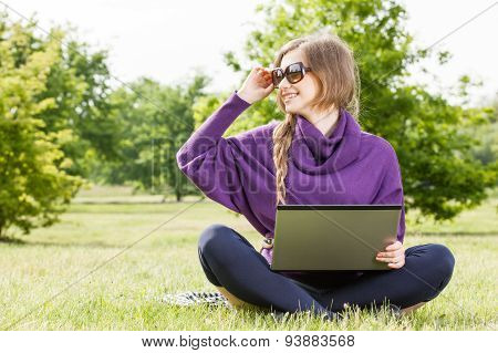 Young Woman Looking At Her Laptop