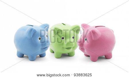 Three colorful piggy banks