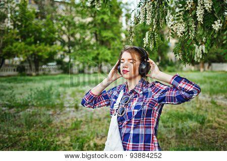 Hipster Girl Enjoying Music On Headphones.