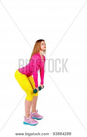 Sportswoman Doing Exercises On Her Back With Dumbbells.