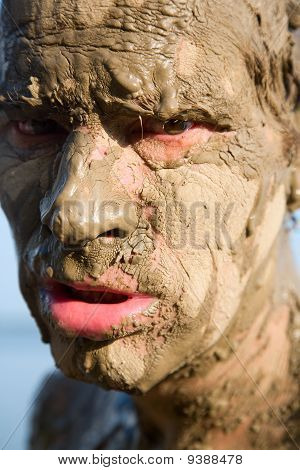 Man's Face Is Very Dirty In The Mud