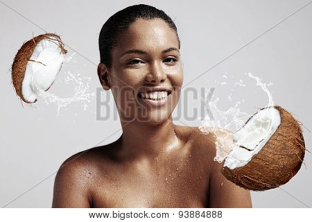 Portrait Of A Woman With A Drops On Her Wet Skin And Broken Coconut