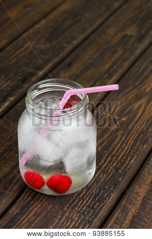 Cold Cherry Drink In Glass Jar On Wooden Board