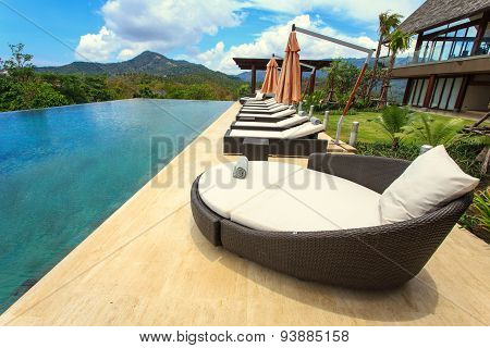 Sun Loungers Stand At The Pool And Beutiful View