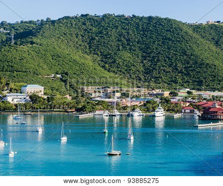 White Sailboats In Blue Bay Under Green Hills