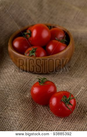 Couple Of Red Cherry Tomatoes On Jute Cloth