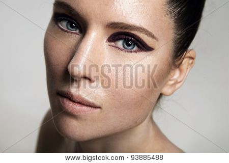 Girl With A Bright Eye Makeup And Ideal Skin