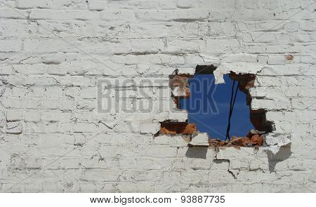 Section Of A Brick Wall With A Hole In It