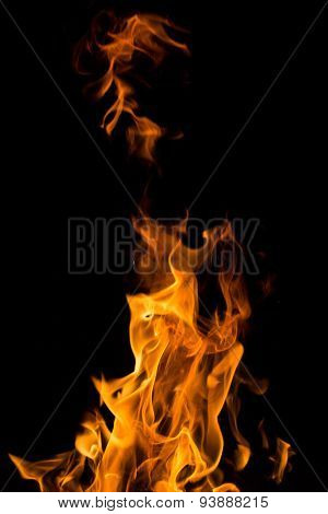 Real fire flames isolated on black