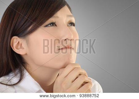 Pray concept of Asian business woman portrait.