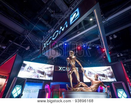 LOS ANGELES - June 17: XCOM 2 game Alien help Human characters sculpture group at E3 2015 expo. Electronic Entertainment Expo, commonly known as E3, is an annual trade fair for the video game industry