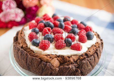 Chocolate Cake with clotted cream and mixed berries