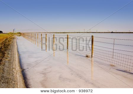 Fence Under Clear Skies