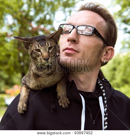 Close Up Cat And Guy Portrait Outdoor