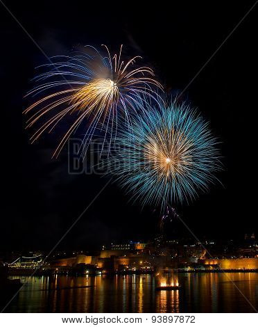 Colorful fireworks explode in Malta in dark sky,Malta fireworks festival,4 July Independence