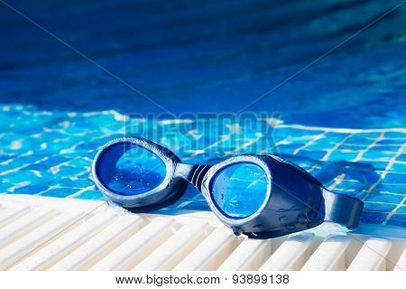 Swimming Pool Goggles On The Poolside