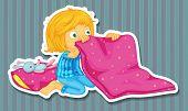 stock photo of pajamas  - Girl in blue pajamas folding blanket - JPG