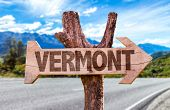 stock photo of burlington  - Vermont wooden sign with road background - JPG