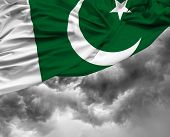 stock photo of pakistani  - Pakistani waving flag on a bad day - JPG