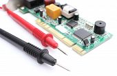 foto of  multimeter  - Closeup of cable multimeter and circuit board isolated on white background - JPG