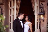 foto of windows doors  - Bride and groom near door with windows - JPG