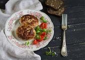 foto of pork cutlet  - pork cutlet and vegetable salad on a dark wooden background - JPG