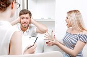 pic of psychologist  - Portrait of a young couple at the doctor - JPG