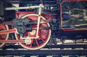 picture of locomotive  - big retro of a wheel a closeup of the steam locomotive on the railroad - JPG