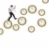 pic of running-late  - Geeky businessman running late against clocks - JPG