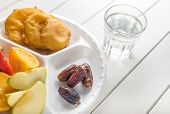 picture of indian apple  - Dates with fruits and fried snacks - JPG