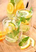 stock photo of iced-tea  - ice tea with citrus fruits - JPG