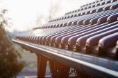 stock photo of roof tile  - Tiled roof of wooden arbor with galvanized gutter  - JPG