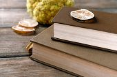 picture of roughage  - Old books with dry flowers and lemon on wooden background - JPG