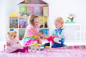 image of stuffed animals  - Kids playing with doll house and stuffed animal toys - JPG