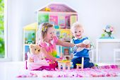 picture of stuffed animals  - Kids playing with doll house and stuffed animal toys - JPG