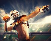 pic of fireball  - Football player throws a fireball with power - JPG