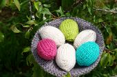picture of gift basket  - Handmade basket of egg Easter symbol traditional culture closeup of egg on green background knit gift from wool to make decorative on holiday - JPG