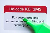 foto of sms  - unicode kci sms with marker on the white background - JPG