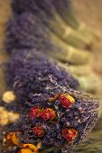 image of bunch roses  - Bunches of dried lavender and roses on a market stall - JPG