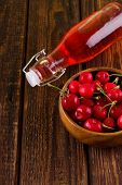 foto of fruit bowl  - Vertical photo of bowl full of fresh harvested red cherries - JPG