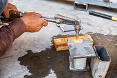 stock photo of torches  - Close up worker do metal cutting with acetylene torch - JPG