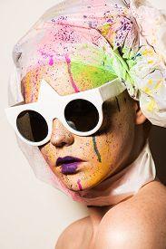 foto of queer  - Portrait of model wearing sunglasses - JPG