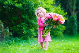 picture of mother baby nature  - Little cute girl with peony flowers - JPG