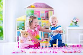 picture of baby doll  - Kids playing with doll house and stuffed animal toys - JPG