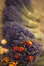 foto of stall  - Bunches of dried lavender and roses on a market stall - JPG