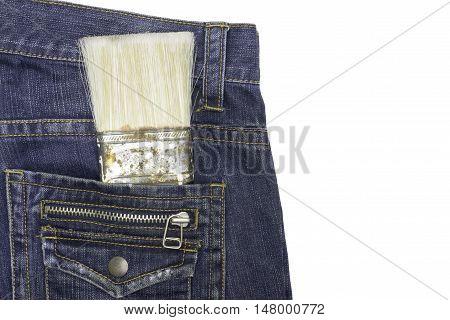 Brush paint in pocket of denim coveralls