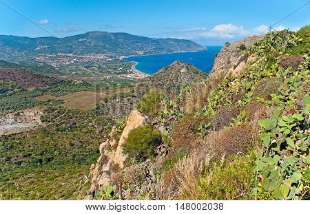 The rocky of Tindari Mount with the view on coastal area covered with gardens Sicily Italy.