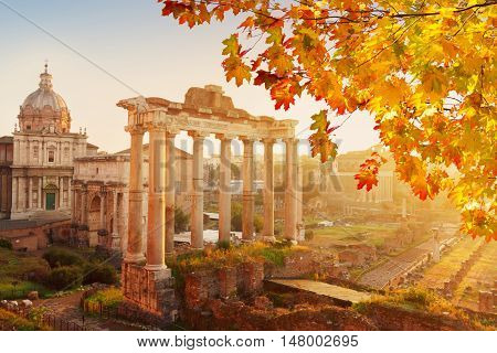 Forum - Roman ruins with cityscape of Rome with sunrire light at fall day, Italy
