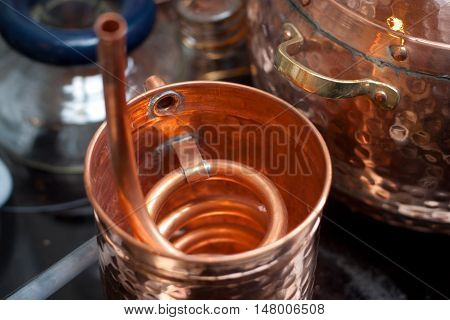 Copper accessories for distillation in the brewery.