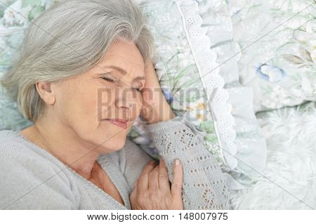 Portrait of a sleeping Senior woman in bed